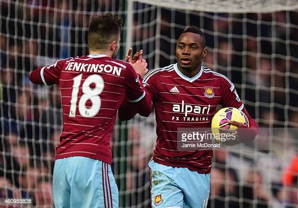 Diafra Sakho of West Ham United celebrates with Carl Jenkinson as he scores their first goal during the Barclays Premier League match between West...