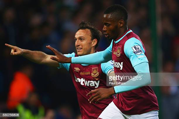 Diafra Sakho of West Ham United celebrates with team mate Mark Noble as he scores their first goalduring the Barclays Premier League match between...