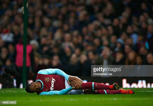 Diafra Sakho of West Ham United holds his leg with an injury during the Barclays Premier League match between West Ham United and West Bromwich...