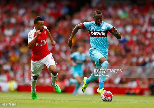 Diafra Sakho of West Ham United is chased down by Francis Coquelin of Arsenal during the Barclays Premier League match between Arsenal and West Ham...