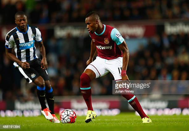 Diafra Sakho of West Ham United is closed down by Chancel Mbemba of Newcastle United during the Barclays Premier League match between West Ham United...