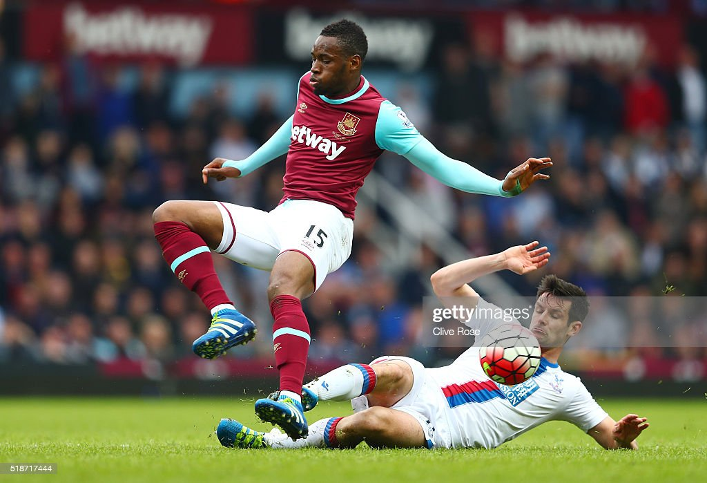 Diafra Sakho of West Ham United is tackled by Scott Dann of Crystal Palace during the Barclays Premier League match between West Ham United and Crystal Palace at the Boleyn Ground on April 2, 2016 in London, England.