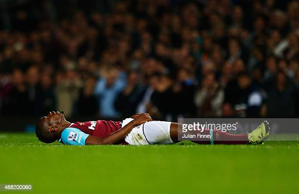 Diafra Sakho of West Ham United lies on the ground after missing a chance at goal during the Barclays Premier League match between West Ham United...
