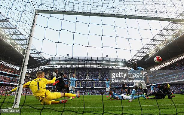 Diafra Sakho of West Ham United scores his team's second goal past Joe Hart of Manchester City during the Barclays Premier League match between...