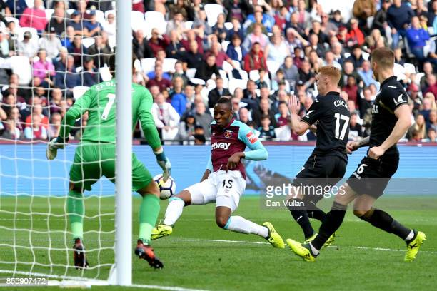 Diafra Sakho of West Ham United scores the opening goal past Lukasz Fabianski of Swansea City during the Premier League match between West Ham United...