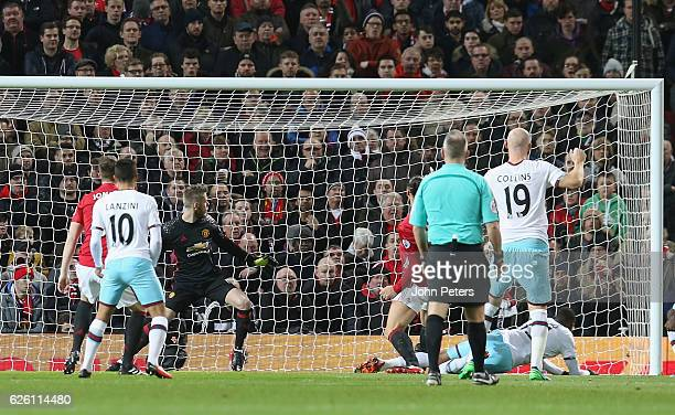 Diafra Sakho of West Ham United scores their first goal during the Premier League match between Manchester United and West Ham United at Old Trafford...