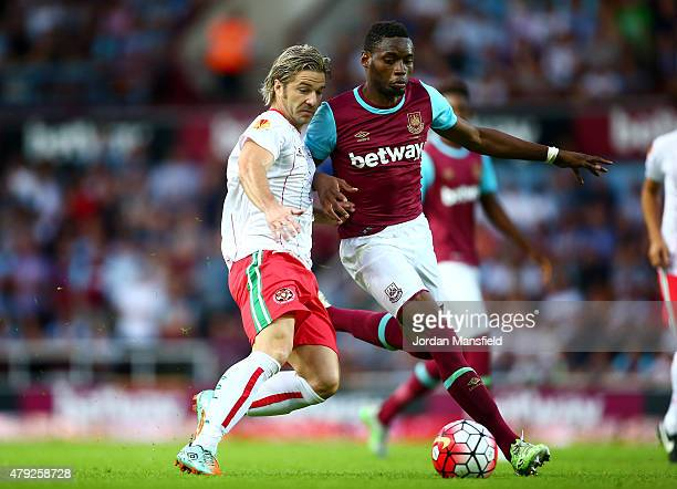 Diafra Sakho of West Ham vies with Edu Moya of FC Lusitans during the UEFA Europa League match between West Ham United and FC Lusitans at Boleyn...