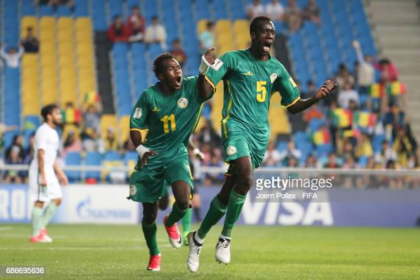 Diagne Cavin of Senegal celebrates with teammates after scoring his team's second goal during the FIFA U20 World Cup Korea Republic 2017 group F...