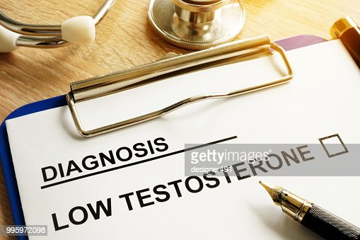 Diagnosis Low testosterone and pen on a desk. : Stock Photo