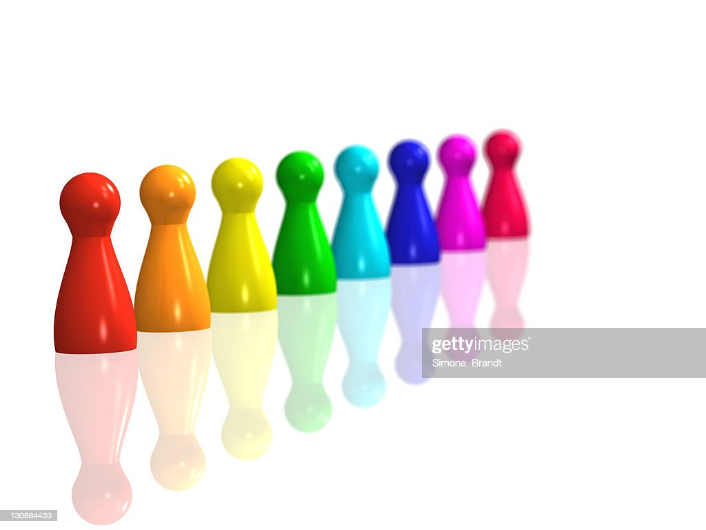 Diagonal Row Of Rainbow Coloured Game Pieces On A Shiny White Surface 3