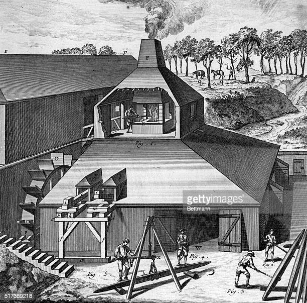 Diagrammatic illustration depicting an iron melting furnace and courtyard in France circa 1770 The wall of the furnace building is cut away to show...