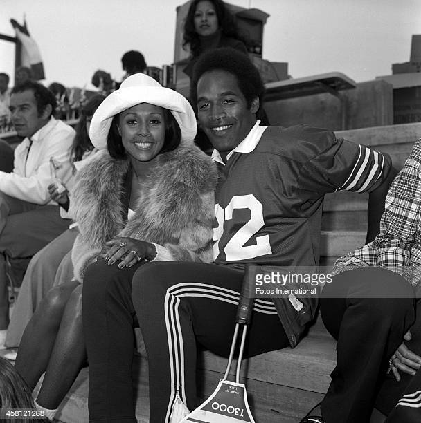 Diahann Carroll and OJ Simpson pose for a portrait during the First Diahann Carroll Tennis Tournament held for underprivileged children on May 13...