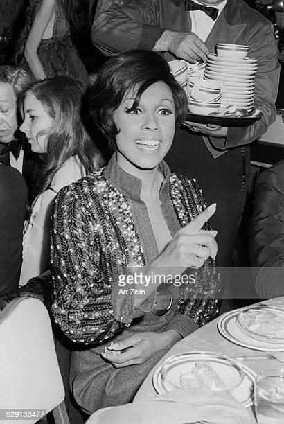 Diahann Carroll in conversation at a formal dinner circa 1970 New York