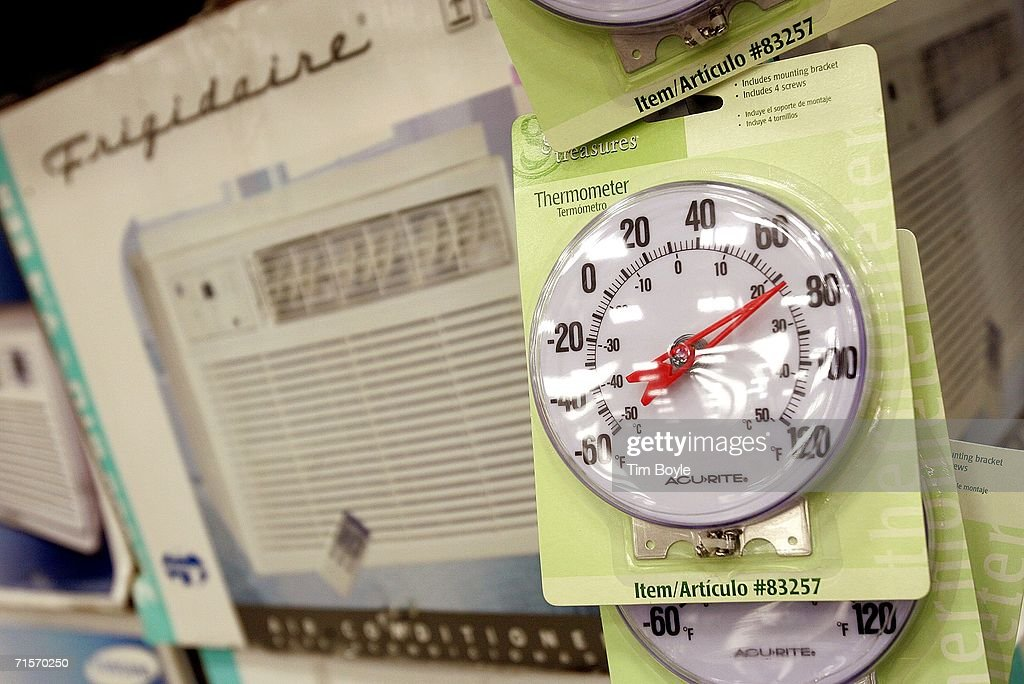 Dial thermometers hang inside a Lowe's home improvement store August 2, 2006 in Arlington Heights, Illinois. With the heat wave blanketing much of the Midwest and now the East Coast, retailers have reported a spike in sales of air conditioners and fans.