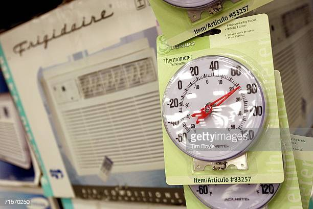 Dial thermometers hang inside a Lowe's home improvement store August 2 2006 in Arlington Heights Illinois With the heat wave blanketing much of the...