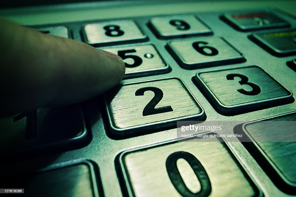 Dialing numbers on an ATM : Stock Photo