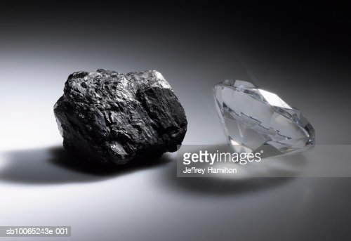 Diamond and piece of coal  Stock Photo