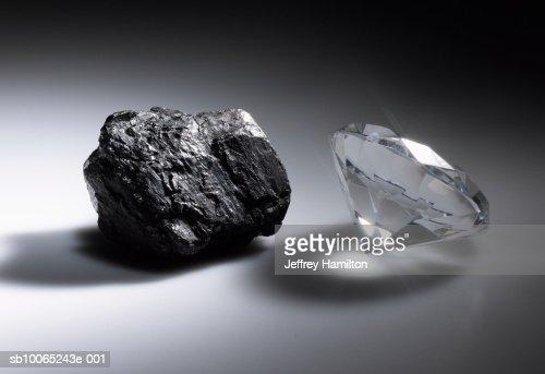 Diamond and piece of coal : Stock Photo