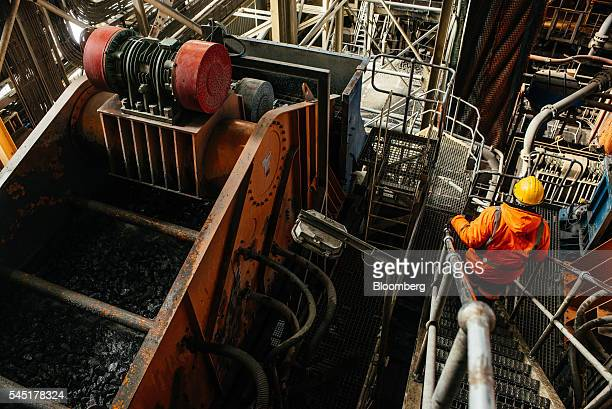 Diamond bearing rock ore also known as kimberlite passes through a processing machine to liberate diamonds at the Letseng diamond mine operated by...