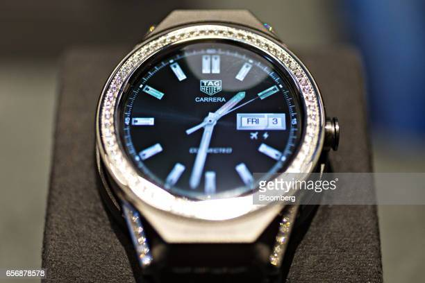 A diamond bezel Connected Modular 45 model luxury smartwatch produced by TAG Heuer International SA stands on display during the 2017 Baselworld...
