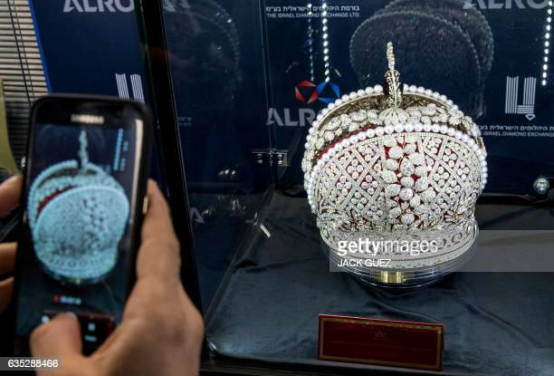 A diamond buyer takes a picture of a replica of Russian Queen Catherine the Great's imperial crown which was used in the coronations of all Russian...