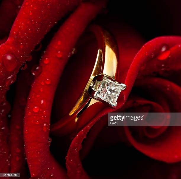 Diamond engagement ring hidden inside pink rose