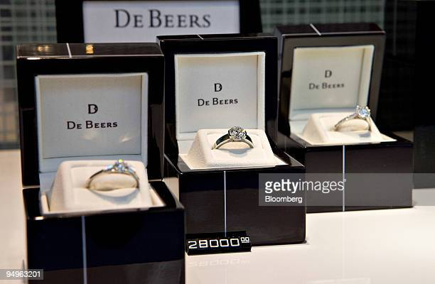 Diamond engagement rings sit on display in the window of De Beers in New York US on Monday July 6 2009 Consumers are coping with the recession by...