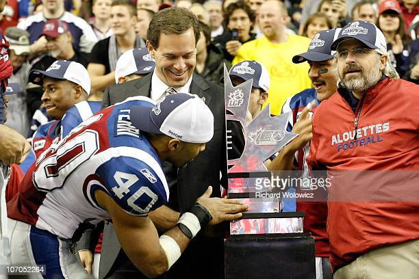Diamond Ferri of the Montreal Alouettes inspects the Eastern Conference trophy during the CFL Eastern Finals game Toronto Argonauts at the Olympic...