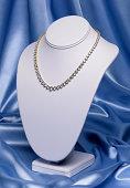 Diamond necklace on jewelry stand, studio shot