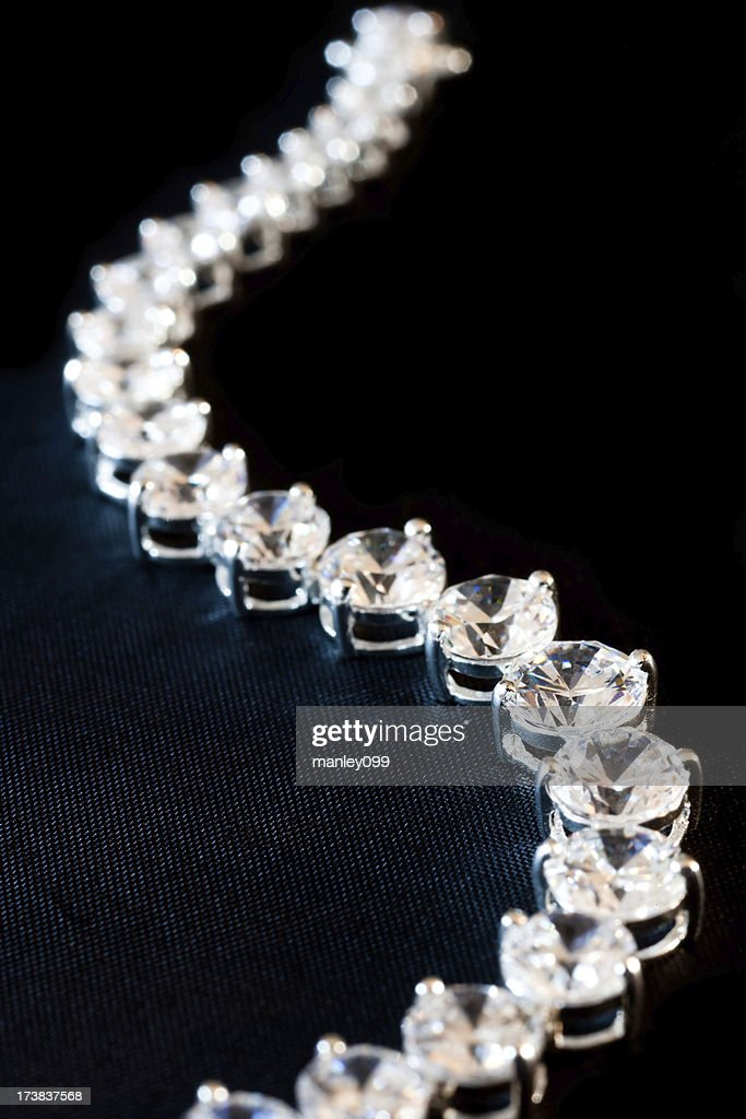 diamond necklace with textured background