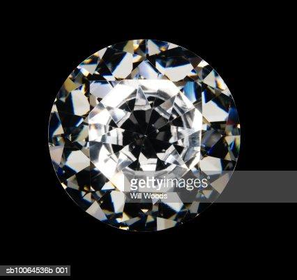 Diamond on black background, overhead view : Stock Photo
