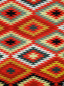 Pattern Red, Orange, White, Green, Black, and blue Diamond Blanket/ Rug - Navajo Artist, made about 1885 of cotton and wool.