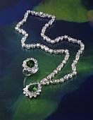 Diamond ring and necklace with jewels, high angle view