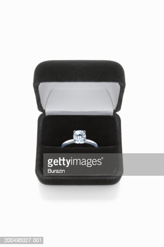 Diamond ring in box, against white background, close-up