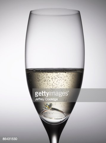 Diamond Ring in Champagne Glass : Stock Photo