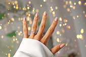 Beautiful Diamond ring on a finger. Holidays and celebrations concept.