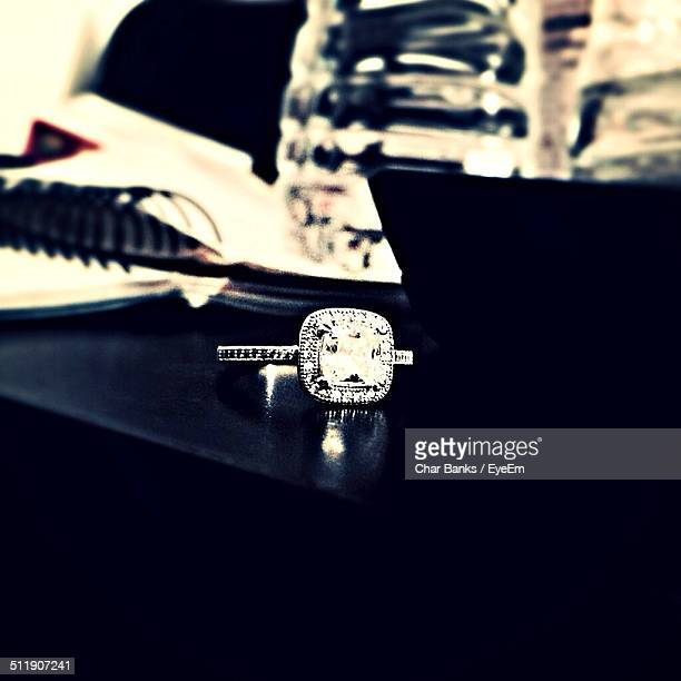 Diamond ring on table