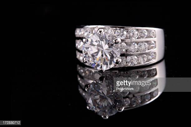 Diamond ring reflected on black background