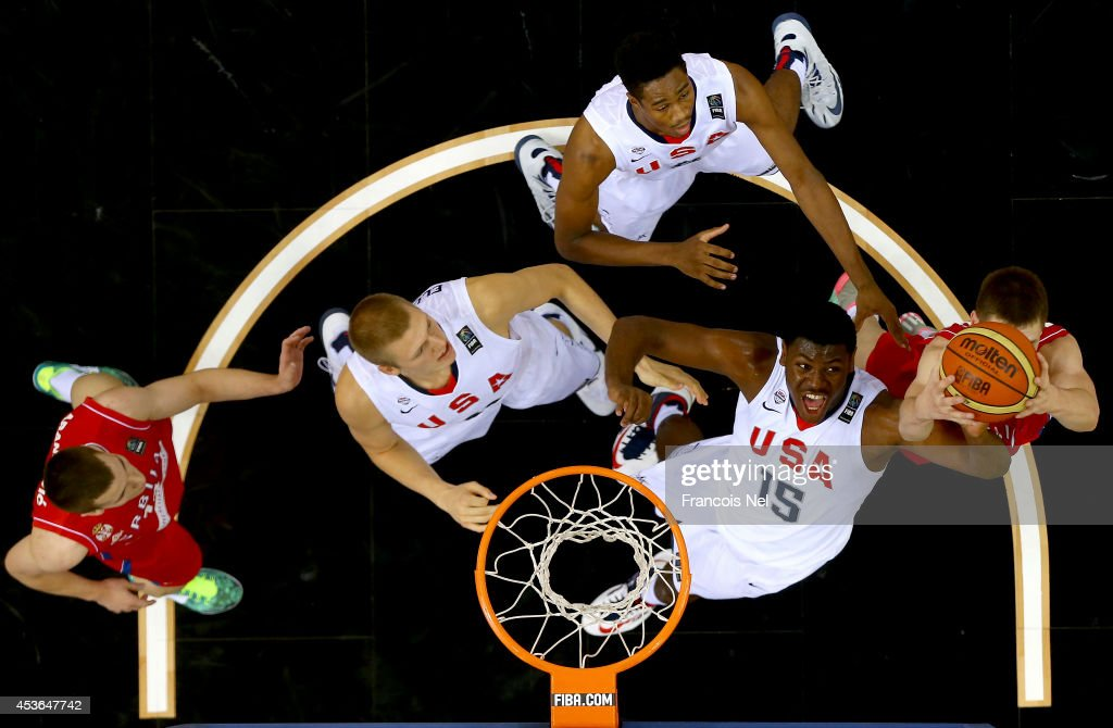 Diamond Stone of the United States competes for the rebound with Nikola Popovic of Serbia during the FIBA U17 World Championships Semi-Final match between Serbia and United States of America at the Hamdan Sports Complex on August 15, 2014 in Dubai, United Arab Emirates.