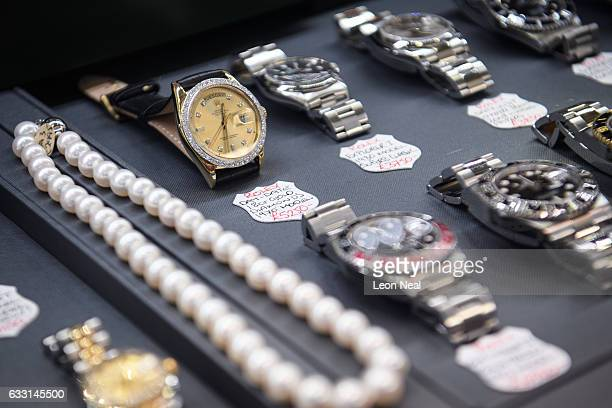 A diamondencrusted Rolex watch is seen in a store window in the financial district also known as the Square Mile on January 20 2017 in London England...