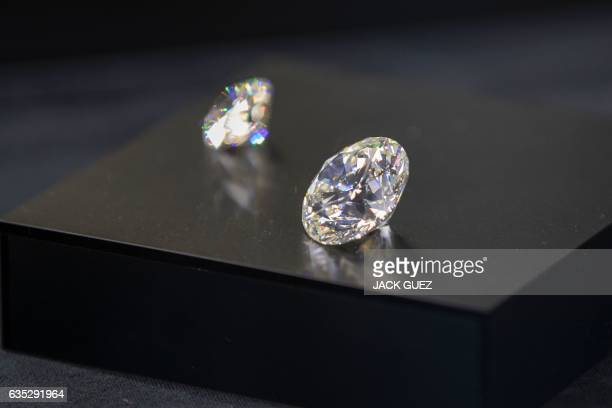 Diamonds are displayed during the International Diamond Week in the Israeli city of Ramat Gan east of Tel Aviv on February 14 2017 Some 400 buyers...