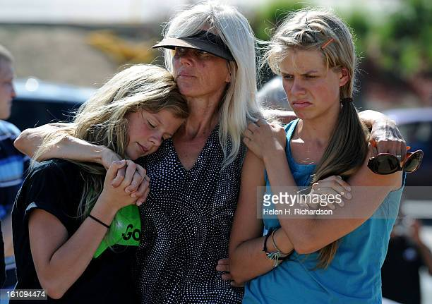 Dian Sikkema brought her two young daughters Shadia left and Spenser to see the memorial today July 25th 2012 The family knew one of the victims The...