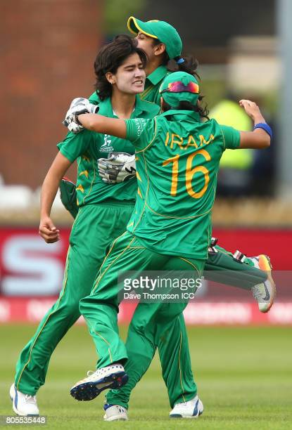 Diana Baig of Pakistan celebrates with Sidra Nawaz of Pakistan and Iran Javed of Pakistan after taking the wicket of Smriti Mandhana of India during...