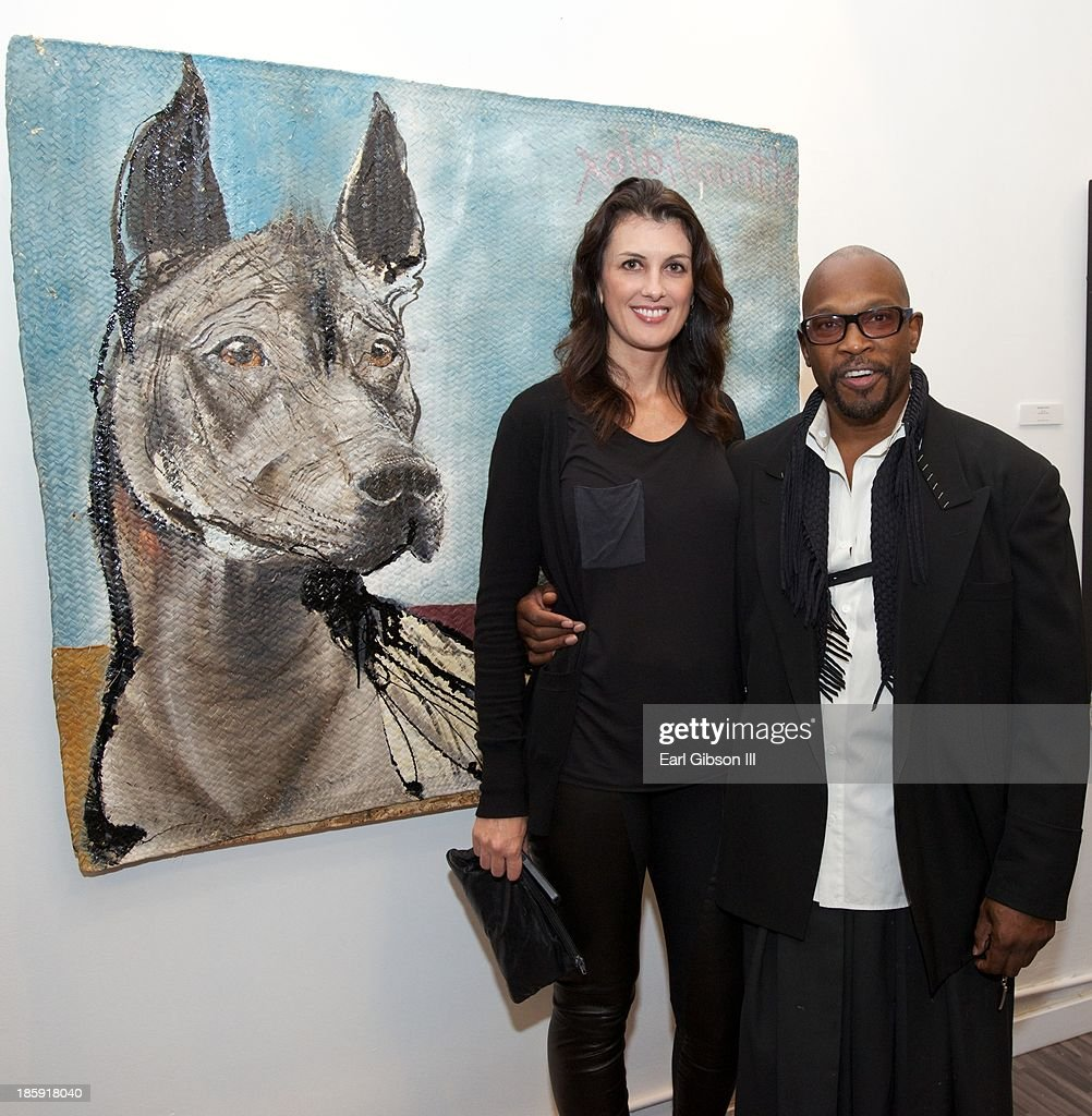 Diana Bianchini and Chaz Guest (artist) pose near one of his images at Quinn Studios on October 25, 2013 in Santa Monica, California.