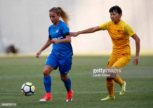 Diana Csanyi of MTK Hungaria FC leaves Begaim Kirgizbaeva of WFC BIIKKazygurt behind during the UEFA Women's Champions League Qualifying match...