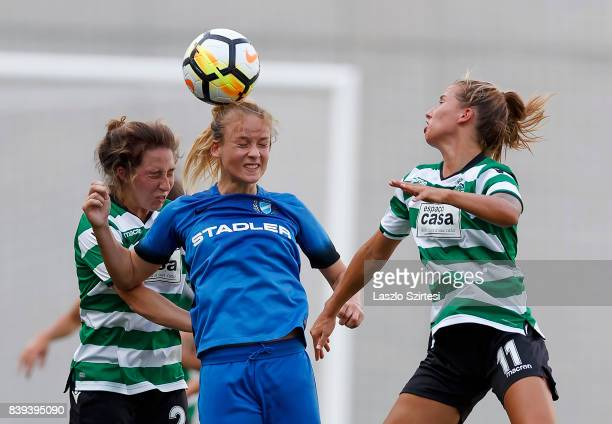 Diana Csanyi of MTK Hungaria FC wins the ball in the air from Carlyn Baldwin of Sporting CP and Tatiana Pinto of Sporting CP during the UEFA Women's...