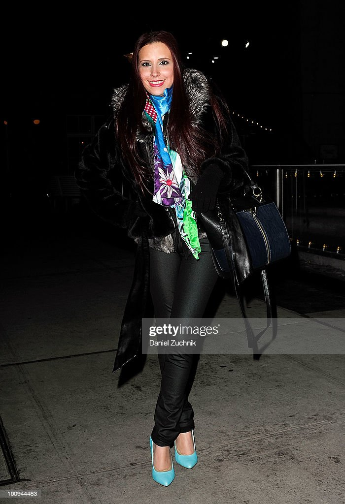 Diana 'Dee' Trillo, stylist/blogger from Miami, seen outside the Scoop party wearing a Guess fur coat, Custo Barcelona scarf, Danielle Nicole handbag and Forever 21 pumps on February 7, 2013 in New York City.