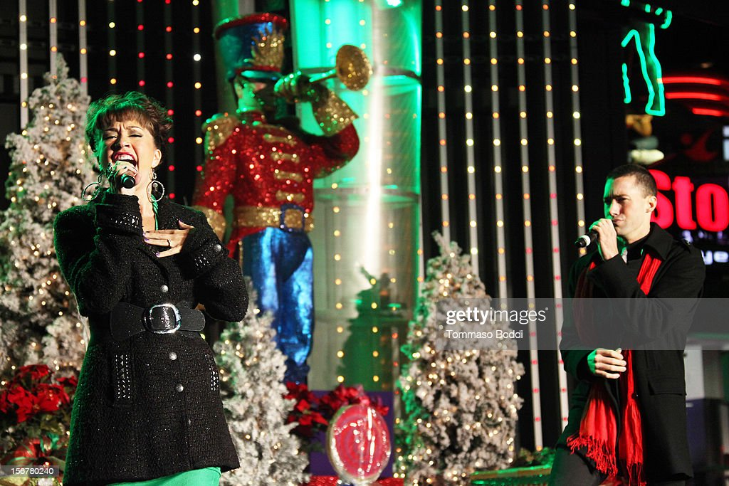 Diana DeGarmo (L) and Ace Young perform at the 2012 Hollywood Christmas Parade Concert held at Universal CityWalk on November 20, 2012 in Universal City, California.
