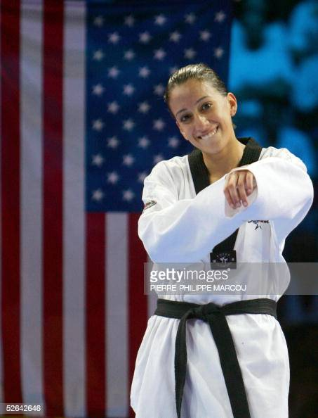 Diana Lopez of the US celebrates her gold medal on the women's under 59 kg final podium at the Taekwondo World Championships in Madrid 17 April 2005...