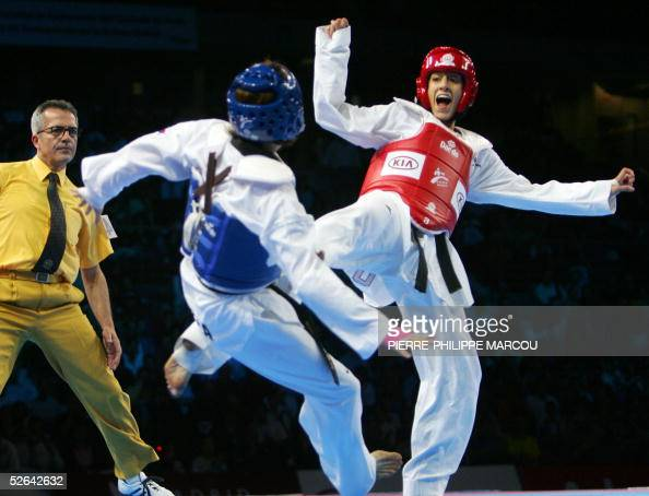 Diana Lopez of the US scores a point on Korean Kim SaeRom during their women's under 59 kg final match at the Taekwondo World Championships in Madrid...
